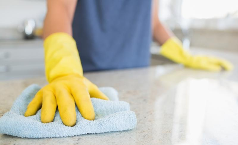 woman-cleaning-the-counter-in-the-kitchen