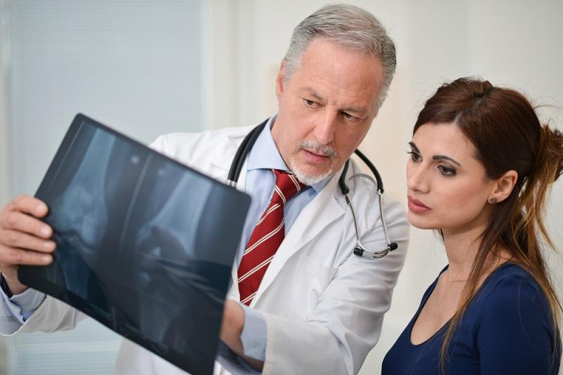 doctor-showing-a-radiography-to-his-patient