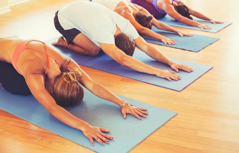 people-relaxing-and-doing-yoga
