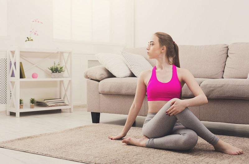 woman-training-yoga-in-twisting-sage-pose